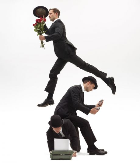 Businessman juggling messages, flowers and work on a typewriter