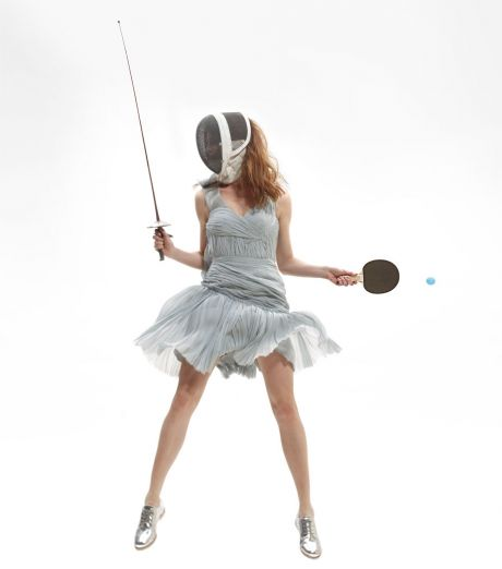 Woman fencing and playing ping pong in a cocktail dress