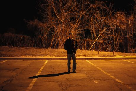 Man standing in an empty parking lot