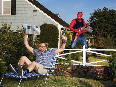 Devil shredding guitar and scaring the iced tea out of his neighbor