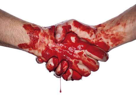 Two bloody hands shaking