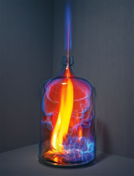 Blue flame in a beaker in corner of a room