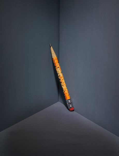 Chewed up pencil in the corner of a room