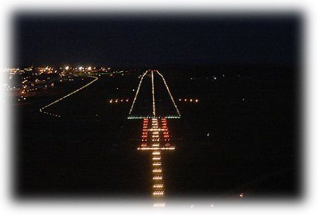 A lit-up runway at night