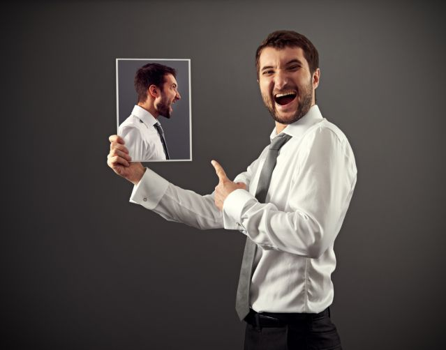 Person laughing at his own image