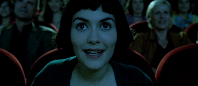 Audrey Tautou in Amélie watching a movie or film
