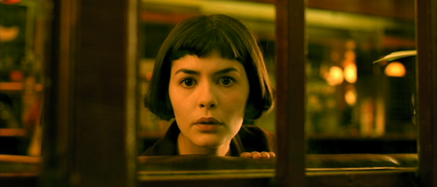 Audrey Tautou in Amélie looking out of the window of a diner