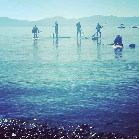 Paddle board yoga on Lake Tahoe