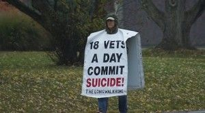 Image from Forbes Magazine of Man with Vets Suicide Sign