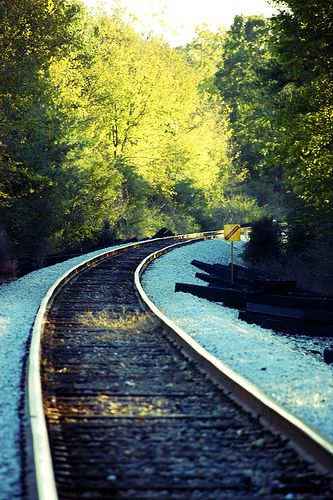 railroad tracks curving into distance