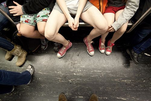 Three people without pants in New York subway car.