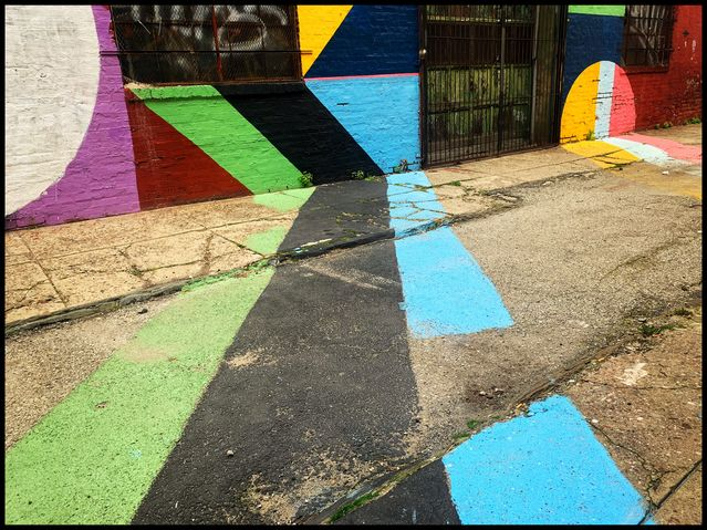 """The Electric Street"" by mural artist David Guinn and lighting designer Drew Billiau. Photo by Anjan Chatterjee."