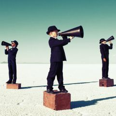 Image: 3 little boys on soapboxes with megaphones