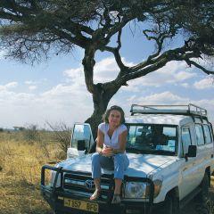 Anthea Rowan sitting on her truck in Tanzania