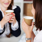 Two woman having a coffee at work