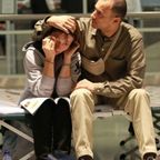 worried couple in airport