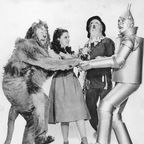 The main characters of The Wizard of Oz, L-R: The Cowardly Lion; Dorothy Gale; Scarecrow; the Tin Man.