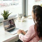 Woman at computer.