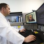 U.S. Air Force Lt. Col. Brendt Feldt at Landstuhl Regional Medical Center conducts a virtual health appointment due to COVID-19.