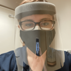 The author wearing personal protective equipment before a patient encounter.