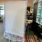 """It's probably not CDC approved,"" says teacher Kerry Kolda of her mobile plastic barrier."