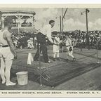 """Irma and Paul Milstein Division of United States History, Local History and Genealogy, The New York Public Library. """"The Rossow Midgets, Midland Beach, Staten Island, N.Y. [close-up of midgets boxing in ring on boardwalk next to bandstand, large audience in background.]"""" The New York Public Library Digital Collections. http://digitalcollections.nypl.org/items/510d47d9-c02e-a3d9-e040-e00a18064a99"""