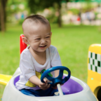 Young child driving pedal car /pixabay