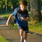 Boy, with back pack, running/PhotoPin