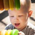 Purchased from Deposit Photos/Adorable boy playing Colorful Abacus