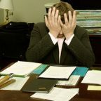 "By LaurMG. (Cropped from ""File:Frustrated man at a desk.jpg"".) CC BY-SA 3.0, via Wikimedia Commons"