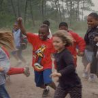Elizabeth Jackson; image title: Happy group of children playing race. Image from Public domain images website Wikimedia Commons.