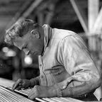 Midvale Company employee inspecting bar steel, October 1930, by Kheel Center Flickr Licensed Under CC BY 2.0