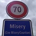 Wikimedia Commons/Francais. Panneau L'entree de la localite de Misery, Canton de Fribourg,Suisse by Biijii/Creative Commons Attribution-Share Alike 3.0