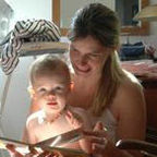 A Mother Reading to Her Daughter At Home In Munich by Andreas Bohnenstengel/Wikimedia Commons/CC BY-SA 3.0