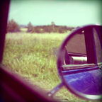"""""""Polaroid Picture of a Rear View Mirror on FSM Syrena 105"""" by Jarek Pelczynski / Wikimedia Commons / CC BY-SA 2.0"""