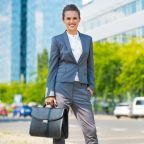 © Citalliance | Dreamstime.com - Business Woman With Briefcase In Office District Photo