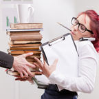 © Giuliofornasar | Dreamstime.com - Man Overloading Colleague Woman With Work Photo