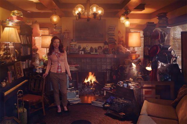 Woman standing in a cluttered living room