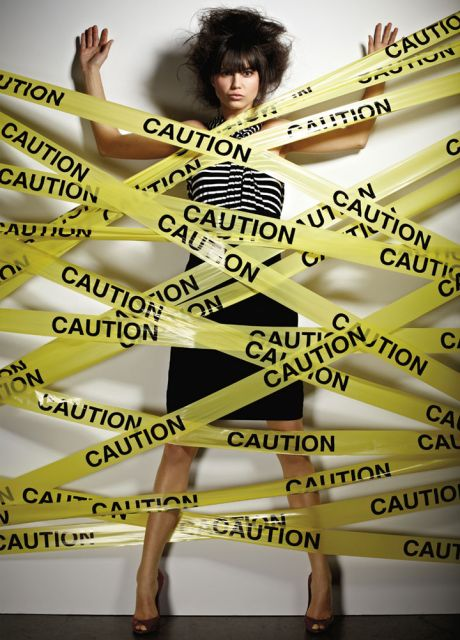 Woman with caution tape on her body