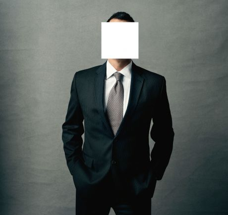 Businessman face hidden