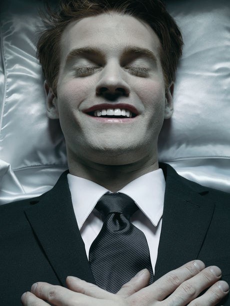 Young corpse smiling in coffin