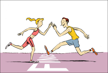 Lady waiting at finish line of race to high five her friend