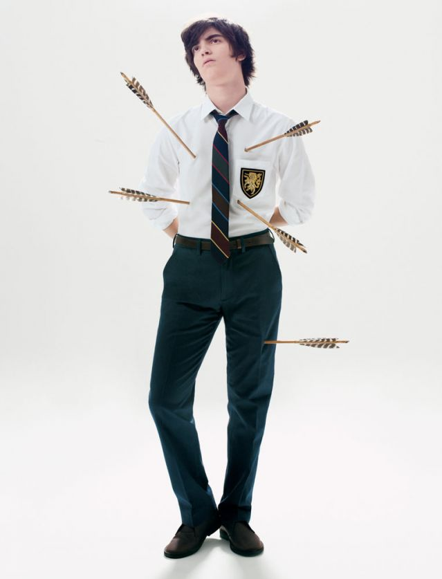 Private school boy with arrows sticking thru his body