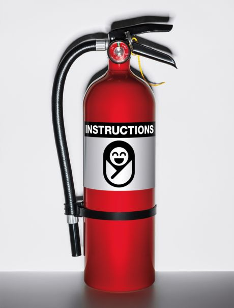 Fire extinguisher with a picture of a newborn baby